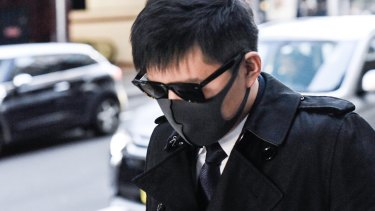 Longwei Xu leaves court during his trial.