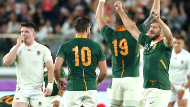 Handre Pollard and Frans Steyn celebrate after the final whistle blows.