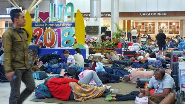 Hundreds of tourists slept at Lombok Airport waiting for the first chance to leave.