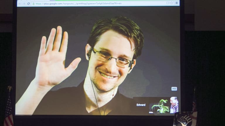 Edward Snowden appears via video link from Moscow at a civil liberties event in Hawaii in 2015. His leaks exposed the mass surveillance practices of the British and US governments, Five Eyes partners of Australia.