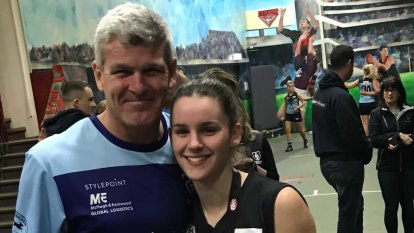 Shaun Smith supportive of daughter Amy, signed by AFLW club North Melbourne