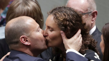 Treasurer Josh Frydenberg is congratulated by wife Amie after delivering the budget speech on Tuesday.