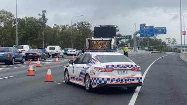 The scene on the Logan Motorway after a man was shot by police.
