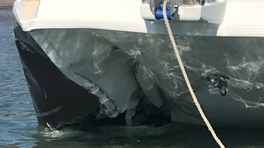 The damaged front section of the catamaran involved in the double-fatality crash.