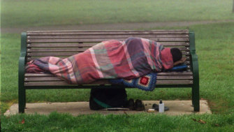 A homeless person in a city park.