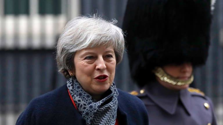 Britain's Prime Minister Theresa May prepares to welcome Japan's Prime Minister Shinzo Abe to Downing Street. Abe has expressed concerns about the effects of a no-deal Brexit.