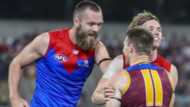 Tempers flare: Demons Max Gawn and Jayden Hunt exchange words with Lion Lincoln McCarthy.