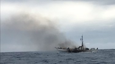 The smouldering wreckage of the charter boat off the Gladstone coast.
