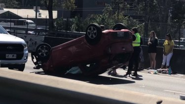 The rollover on the M1 at Loganholme that blocked two southbound lanes.