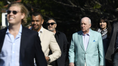 Alan Jones boarding a yacht at Rose Bay Wharf with Wallaby Kurtley Beale ahead of him on Friday.