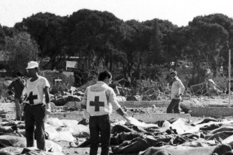 Red Cross and social workers at the Sabra camp work among the victims of the massacre.
