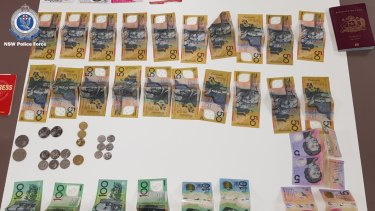 Some of the cash allegedly stolen by the group.