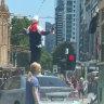 Man arrested, police close major Melbourne CBD intersection