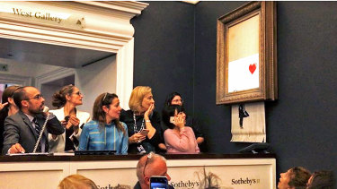 The scene at Sotheby's just after the Banksy sold for  £1 million.