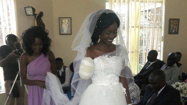 Zanele Ndlovu walks down the aisle on her wedding day at a hospital Chapel in Bulawayo, Zimbabwe.