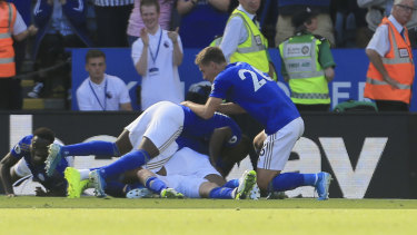 Upset: Leicester's James Maddison is buried by teammates as they celebrate his winning goal.