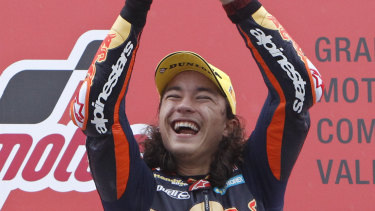 Moto3 rider Can Oncu, who is 15 years old, celebrates his historic victory in Valencia.