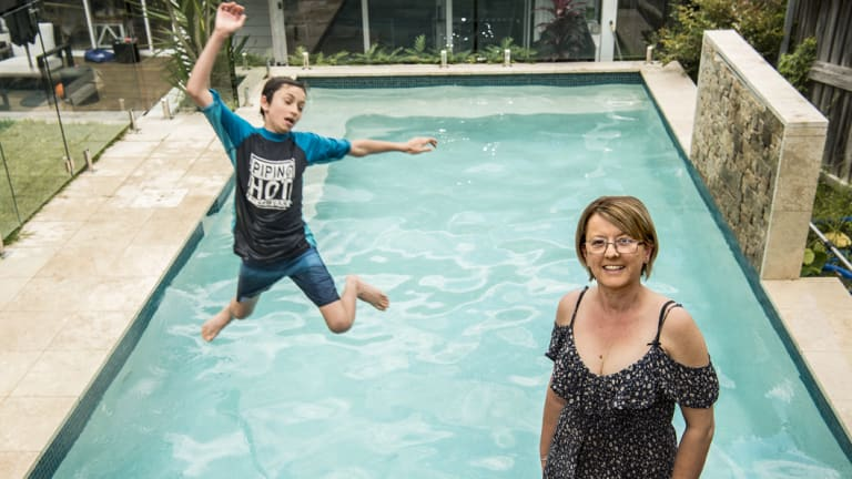 Joshua Boag enjoys the family's swimming pool, while mother Fran Boag saw it as an investment in the property.