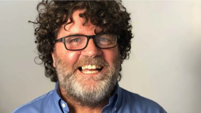 Tributes flow for ABC radio legend Russell Woolf