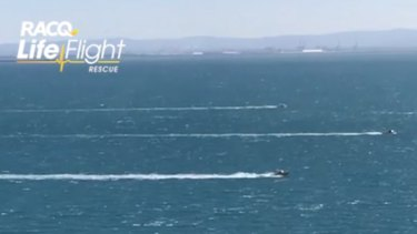 Search vessels systematically sweep Moreton Bay in formation.