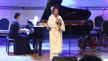 Japanese pianist Kaoru Imahigashi plays the piano for opera singer Fujiko Hirai during a concert to mark the debut of Gaza's only grand piano.