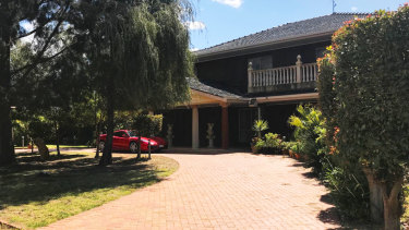Pasquale Cufari's property in Mildura with a red Ferrari parked at the front.