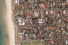 Just one place closer to the beach: But 64 sold for $130,000 more than its neighbouring site.