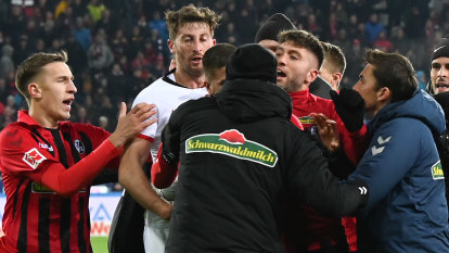 European soccer wrap: Frankfurt captain sees red for coach hit, Lyon bus stoned