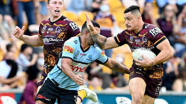Kotoni Staggs of the Broncos makes a bust against Cronulla at Suncorp Stadium in Brisbane.