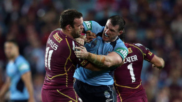 Paul Gallen and Nate Myles try to sort out their differences.