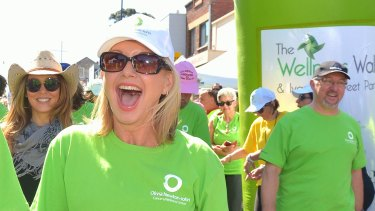 Olivia Newton-John with her husband John Easterling at the start of the Wellness walk in 2014.