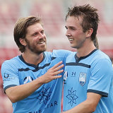 Calem Nieuwenhof celebrates his maiden senior goal with Luke Brattan, the player he's trying to model his game on.