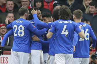 Leicester players celebrate Kelechi Iheanacho's goal, which saw them through against Brentford.