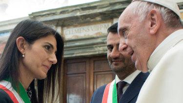 """Symbols of evil are dangerous"": Pope Francis greets Mayor of Rome Virginia Raggi, left, as Naples' Mayor Luigi de Magistris looks on."