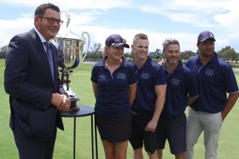 Daniel Andrews presents a trophy at a golf day in aid of the Monash Children's Hospital in November, 2017.
