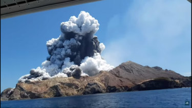 A screen grab of the White Island volcano eruption from a video taken by tourist Allessandro Kauffmann, who was then safely on a boat, in shock.