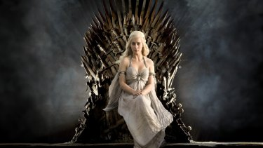 Daenerys Targaryen (Emilia Clarke) sits on the Iron Throne from Game of Thrones.