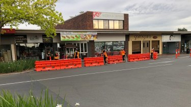 Workers set up new outdoor dining areas for restaurants trading at Pinewood Shopping Centre in Mount Waverley.