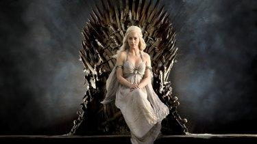 Daenerys Targaryen (Emilia Clarke) sits on the Iron Throne from Game of Thrones.