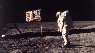 "Time to return, says Pence. Astronaut  ""Buzz"" Aldrin poses for a photograph beside the US flag planted on the moon during the Apollo 11 mission on July 20, 1969."