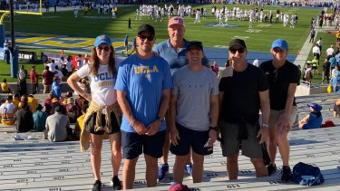 Cameron Ciraldo and Ivan Cleary with AFL and AFLW assistant coaches at a UCLA football game last October.