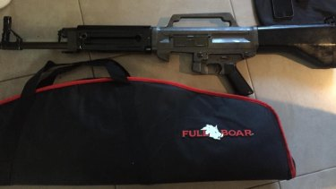 Firearms, ammunition and drug equipment were found on the Gold Coast.