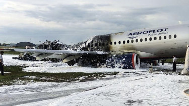 The Aeroflot Sukhoi SSJ100 aircraft is covered in fire retardant foam after an emergency landing at Sheremetyevo Airport in Moscow, Russia.