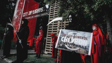 Anti-Chevron protesters outside the Perth Festival venue the oil and gas giant had sponsored.