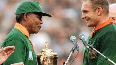 Nelson Mandela presents Francois Pienaar with the World Cup at Ellis Park.