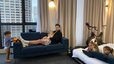 Penthouse rules: The Williams family relax in their CBD apartment.