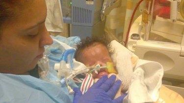 Priscilla Maldonado holds her newborn son Ja'Bari Gray.