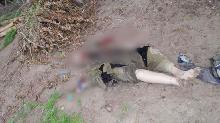 This man, whose right leg is prosthetic, was among Afghans killed in 2009 in incident that involved alleged war crime. We have chosen to blur the image.
