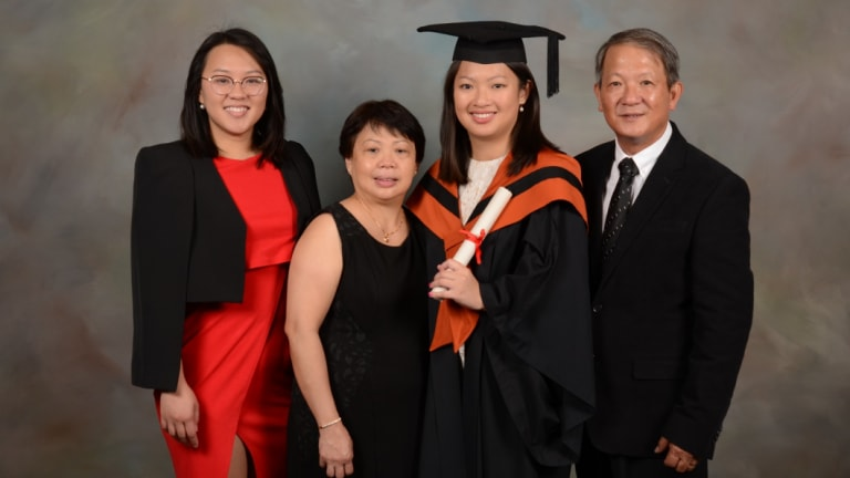 The Nguyen family. Fairfax reporter Han Nguyen, third left, with her sister Duyen, mum Chi and dad Sang at her graduation in May.