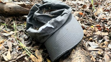 The grey cap found in bushland off a Byron Bay beach that is believed to belong to missing backpacker Theo Hayez.